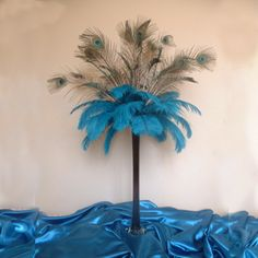 This centerpiece made using peacock feathers AND ostrich feathers in an eiffel tower vase