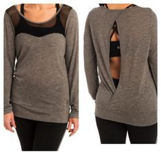 Pure Barre by Splits 59 Nori L/S Top Pure Barre by Splits 59 Nori Long Sleeve Top in charcoal grey with black mesh detail. Silver logo on bottom front. Open back. Loose fit. 50% polyester, 50% viscose. Worn, washed 2x. Excellent condition Pure Barre by Splits59 Tops Tees - Long Sleeve