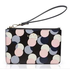 """Kate Spade Wristlet NEW WITH TAGS. COMES WITH ORIGINAL GIFT BOX AND KATE SPADE GIFT BAG!  Kate Spade's latest design. A slim wristlet with one multi-function zippered pocket. Signature Kate Spade New York logo in gold on front. Exterior polyurethane and interior polyester lining. Silver colored zipper. 7 1/4 inch detachable wrist strap. Measures 6 3/4"""" (L) x 4 3/8"""" (H) x 1/2"""" (W). kate spade Bags Clutches & Wristlets"""