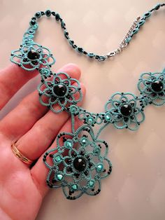 Another new necklace experiment. The thread is size 20 Lizbeth in Country Turquoise Medium . I used Swarovski crystal pearls for the . Tatting Necklace, Tatting Jewelry, Beaded Necklace, Necklaces, Needle Tatting, Tatting Lace, Funky Jewelry, Handmade Jewelry, Thing 1