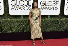 Striking: Kerry Washington wore a yellow lace dress with delicate black heels...