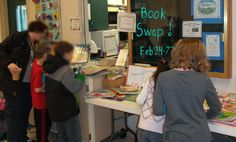 Another picture of the kids picking out books at the 2014 Swap.