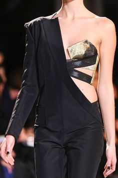 Asymmetric Tailored Jumpsuit with exposed gold bra and chunky strapping - black & gold; sharp line & shape; structured fashion details