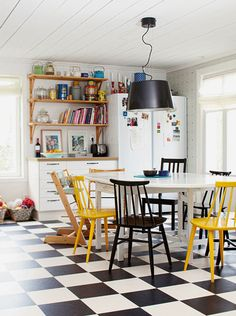 checkered linoleum tiles & mismatched chairs