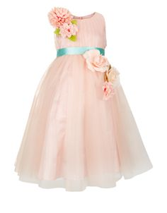 Our perfectly pretty Camellia tulle dress for girls is adorned with flower corsages, and cinched at the waist with a contrast satin sash that ties to a bow at the back. This piece is lined in smooth satin for a comfortable fit, and features a concealed side zip fastening.