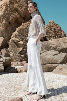 45d57d06f93 The Yulia Pant in white featuring wide-leg with gathered slits. Mid- rise