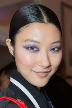 Jason Wu: Jason Wu debuted his new makeup line with Lancome backstage, where the eyes were dusted with an indigo metallic shadow.