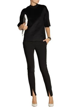 Black woven polyester-blend  Two front slant pockets, seam detail, split cuffs, two back slit pockets  Concealed hook, button and zip fastening at front 53% polyester, 43% wool, 4% elastane Dry clean