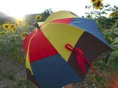 Pumpkinbrella parasol by DiCesare Designs among the sunflowers in Italy. Pumpkinbrella - a unique and cute brella by DiCesare.