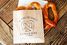 """Provide guests with a late-night snack.  After all that dancing, they've worked up an appetite! These pretzel bags are cute for after you've """"tied the knot"""". By Mavora Art & Design. http://emmalinebride.com/planning/things-guests-love-at-weddings/"""