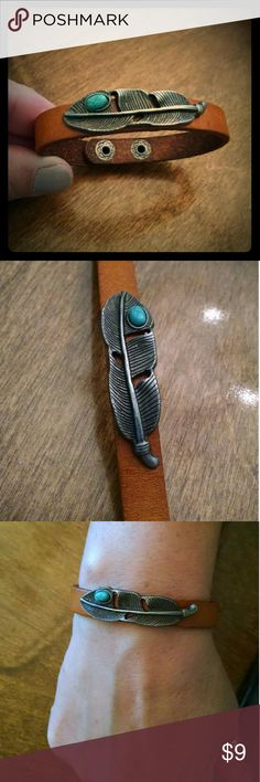 """*NEW* Leather & feather bracelet faux turquoise Brand New Item!! Genuine leather with metal feather. Faux turquoise cabachon. 2 button snaps. Total length is 7 1/8"""". Width is 3/8"""". Any questions, just ask! Jewelry Bracelets"""