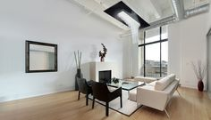 White minimalist style informs this modern living room. Metal framed, white cushion sofa stands across a large glass coffee table from white fireplace surround, with floor to ceiling glass overlooking patio. Living Room Ceiling Fan, Home Ceiling, Living Room Flooring, Living Room Art, Living Room Modern, Modern Floral Wallpaper, Paisley Wallpaper, Of Wallpaper, Detroit Wallpaper