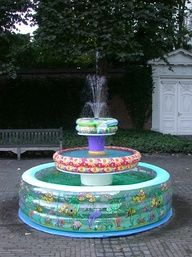 @Rhonda Alp MacLean, we are so doing this for masons birthday ....way cool..The Inflatable Swimming Pool Fountain...So cute ~ would be great at a backyard picnic or kids birthday party to use as a wishing well...where they could toss their pennies in and make a wish....fun idea for an outdoor bridal/wedding shower...I just love the Whimsy factor of this....deffinitely screams...Summer FUN