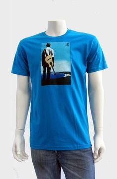 Buena Vista (Turquoise )  The Buena Vista Tee depicts a musician over looking a scenic panorama with acoustic guitar slung over his back. Screen printed with 6 colors onto 100% combed cotton jersey premium fitted crew with custom tag on hem. WRAP certified (worldwide responsible accredited production).   ...