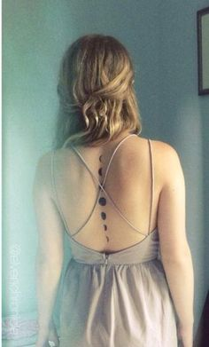 A down-the-spine temporary tattoo of the phases of the moon to show off a backless dress.   Photo:  Etsy
