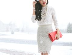 GORGEOUS. White lace skirt. White sweater. Layers of beaded/pearl necklaces. Colored clutch.