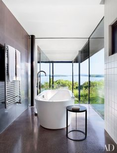 In architect Steve Mensch's house overlooking the Hudson River in Rhinebeck, New York, the side table in the master bath is by B&B Italia.