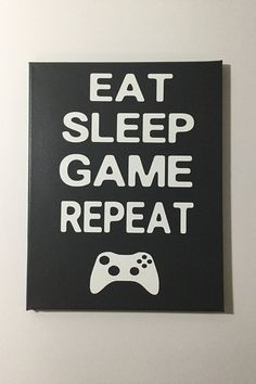 EAT SLEEP GAME REPEAT. This is a Painted Canvas Sign. It is a stretched canvas so it has a pine wood frame with thick canvas wrapped around than painted using a special technique. Available in 3 different sizes: 11x14 inches 12x16 inches 16x20 inches Available in these colors