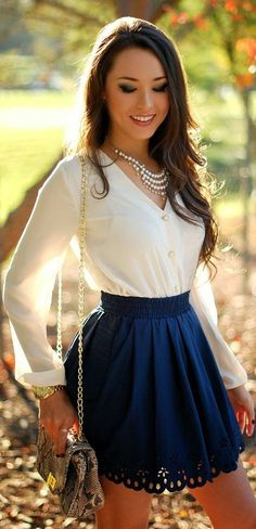 elegant blouse and navy blue skirt