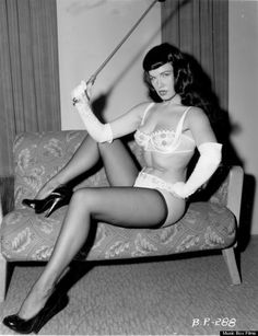 Bettie Page  ·  Time to get back to work.... NOW!!! ❗️  #BettiePage #domme #fetish #whip #pinup #lingerie #vintage #retro #kink  ~Thanks to Bettie Page Reveals All!~