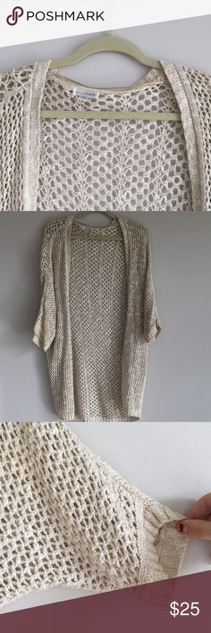 Long Knitted creme Cardigan Knitted Cardigan that goes to the upper thigh about. Gentle use, good condition. No loose strings. Purchased from Charming charlie's. This could easily fit anyone from an XS-Med Charming Charlie Sweaters Cardigans