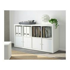 Ikea Kallax 49.99€ 77x39x147 attached to wall above bed