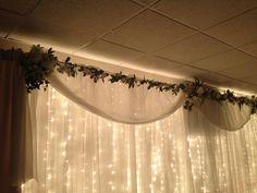 Wedding decor  lights and white flower arrangements