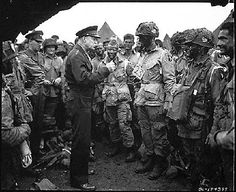 D-Day, June 6, 1944.  U.S. Army General Dwight D. Eisenhower speaks with 101s Airborne Division paratroopers before they board airplanes and gliders to take part in a parachute assult into Normandy as part of the Allied Invasion of Europe