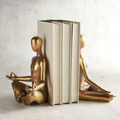 Pier 1 Imports Yoga Couple Bookend Set ($32) ❤ liked on Polyvore featuring home, home decor, small item storage, gold, pier 1 imports, yoga home decor and handmade home decor