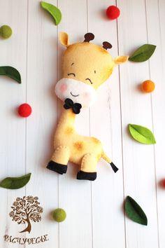 Купить или заказать Игровая игрушка из фетра 'Жираф' в интернет-магазине на Ярмарке Мастеров. 'Если кто-то самый длинный, Все зовут его жираф. Посмотрите, как красив он - Вовсе не похож на шкаф. Достаёт он с верхней ветки Почки сочные, листву.. Повезло жирафу с шеей Все завидуют ему!' Жирафик любит гулять на свежем воздухе, лакомиться листочками и греться под теплым солнышком =) Малыш получился ростом почти 23 см - очень его удобно будет обнимать маленькой крохе! Фетровая игрушка 'Жир…