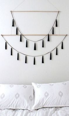 Nate Berkus' Target home collection is nothing short of amazing. Fringe pillows, glass stools, ceramic lamps, and tassel throws galore!