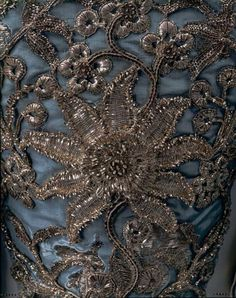 """This particular silk and silver thread robe à la Française evokes thoughts of Versailles during the gallant, licentious, rose scented aegis of Louis XV and his divinely fair mistress Madame de Pompadour, but is in fact English in origin so would have been worn at the rather more staid (in appearance anyway) court of George II."""