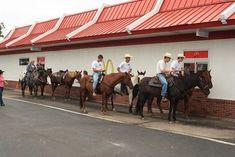 Horses and riders at McDonalds drive through. OMGosh!  I love it!