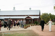 The side entrance to the barn and front of the pavilion | Heritage House | Dripping Springs | Photography by Vanessa | Bride & Groom |
