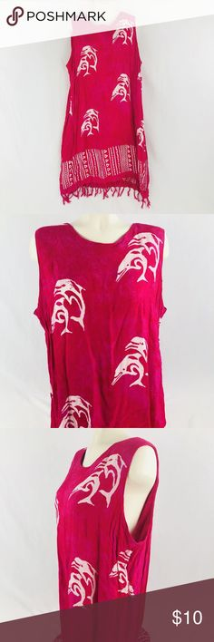 """InGear 1X Bright Pink Dolphin Swim Cover Up Fringe This sleeveless hot pink swim suit cover up has a jumping double dolphins scattered throughout.  It has a fringe along the bottom hem and would be perfect to wear while lounging at the beach or pool.   Measurements (taken with garment laid flat): Length: 36 1/2"""" Waist: 23"""" Pit to Hem: 29"""" Bust: 24"""" Bottom Hem: 27""""  Good used condition with no rips, tears, stains or holes. There are some white spots on the garment, which were caused during…"""