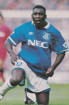 """FOOTBALL PHOTO>DANIEL AMOKACHI Everton 1995-96 - £2.00. football photo ... Daniel Amokachi who played for Everton between 1994 and 1996 ... photo is printed on Fuji photographic paper and measures 6"""" x 4"""" ... NEW .... will be sent in a board-backed envelope .... Post & Packing UK £1.00, Europe £2.00. Rest of World £3.00 Powered by eBay Turbo Lister Track Page Views With Auctiva's FREE Counter 382810099176 Premier League, Gary Speed, Everton Fc, Retro Football, Football Photos, War, Baseball Cards, Printed"""
