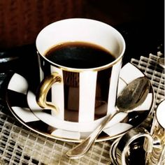 I'd love to drink coffee out of a black and white cup - especially with a gold handle