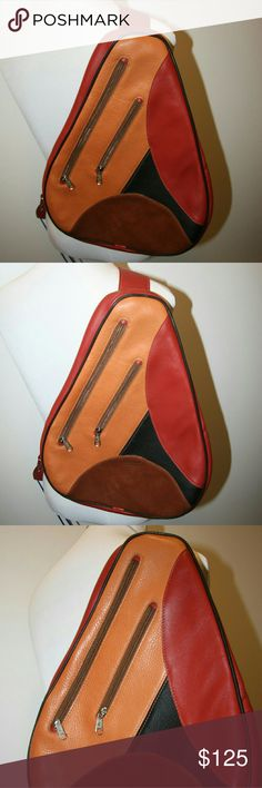 Rare DIAGONAL Leather Slingpack DIAGONAL Leather Slingpack Boutique brand DIAGONAL Multi-color Retro Look New (never used) / NWOT Fully Lined Two Exterior Zippered Pockets One large zippered compartment on the underside with interior zippered pocket. Wide adjustable strap  Red, black and orange smooth leather with brown suede imprinted with Diagonal Diagonal Bags Backpacks