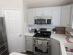Kitchen refinished in Sherwin Williams light french gray by Chameleon Painting SLC UT. Refinishing Cabinets, Kitchen Refinishing, Kitchen Cabinets, Cabinet, Refinishing Furniture, Home Decor, Kitchen, Kitchen Appliances, Laundry Room Cabinets