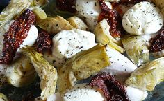 Homemade Marinated Artichoke Hearts   Take advantage of artichoke season and make your own marinated artichoke hearts.  This versatile dish can be used in a hundred ways in the kitchen.  Toss the artichoke hearts with pasta, puree them to make a sauce or dip, add them to a sandwich, or eat the hearts on their own as part of an antipasto platter. - Foodista.com