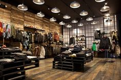 Lighiting & Reclaimed Wood Slatwall- Atrium & Kith store, New York store design Retail Store Design, Retail Shop, Visual Merchandising, Clothing Store Design, Store Layout, Slat Wall, Retail Interior, Coffee Design, Retail Space