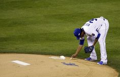 Kansas City Royals pitcher Yordano Ventura writes on the mound before the first inning of Game 6 of baseball's World Series against the San Francisco Giants Tuesday, Oct. 28, 2014, in Kansas City, Mo. (AP Photo/Jeff Roberson)