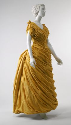 1880s silk evening dress, with outer layers draped to resemble Ancient Greek sculpture