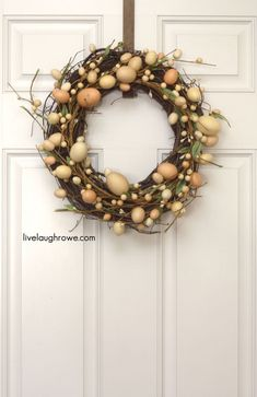 For those short on time, just head to the craft store and pick up an egg garland and a grapevine wreath. Intertwine the two and show off your new decoration. Get the tutorial from Live Laugh Rowe  »