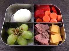 school lunch: hard boiled egg, grapes, carrots, red pepper slices, roast beef, and cheese