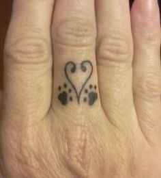 Heart and paws tattoo