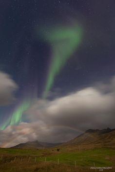 A moonbow and the aurora borealis captured above Fáskrúðsfjörður in Iceland.