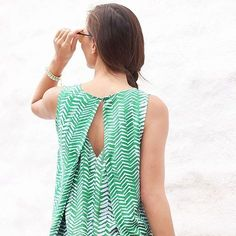 Love the interesting back of course. Plus I don't have much green in my closet.