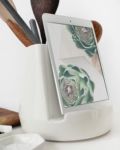Good gadget design. Utensil and iPad holder, all in one