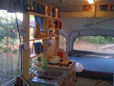 pop-up camper shelves; modifications; I like the cooling rack over the sink to use for extra counter space or a drainer for dishes - so simple!